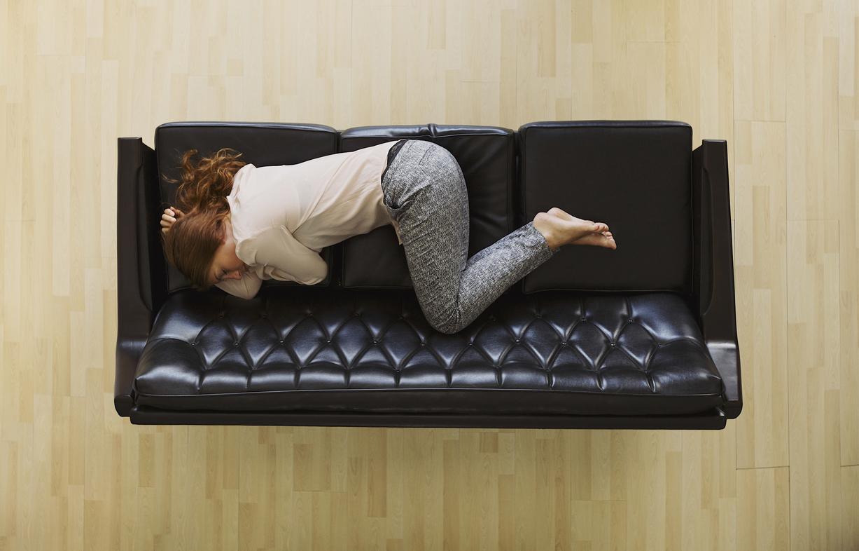 Woman lying (or laying) down